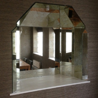 Antique bronze mirror faceting